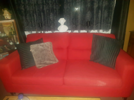 Red sofa with black cushions