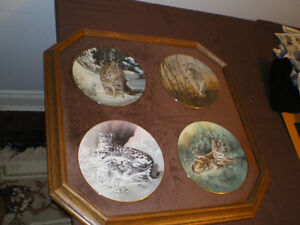 Four Big Cats collector plates.