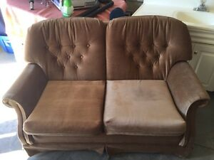 Brown couch and chair