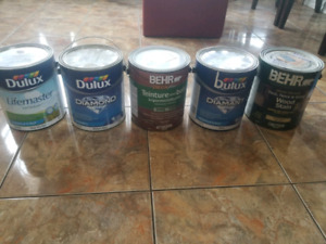 Unopened cans of paint and stain