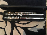 Yamaha flute with books and music stand