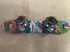 Kids burton snowboard with bindings and boots.