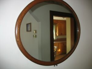 Antique wood framed oval mirror.