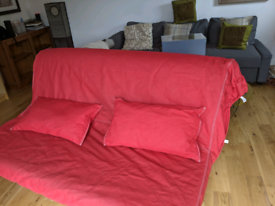 Red IKEA double sofa bed