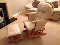 Babylo reclining rocking chair and foot stool .