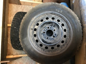 4 Studded winter tires on rims
