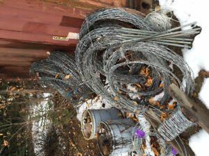 Coiled 4 prong heavy gauge barbed wire