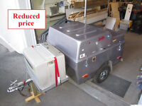 Small closed luggage trailer for car or motorcycle with cooler