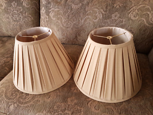 2 gold lampshades