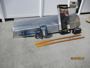 12 Foot Aluminum Boat with a gas and electric motors.