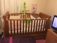 Sleigh cot bed in antique finish