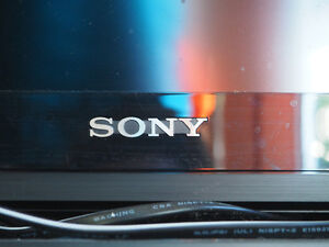 """Sony Bravia LCD TV, 40"""" screen, with remote and HDMI cable."""