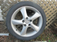 4 aluminum wheels and tires off 2002 mazda 6