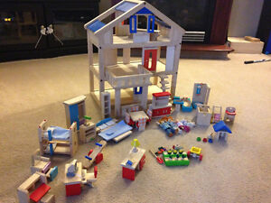 Plan toys wooden dollhouse and accessories