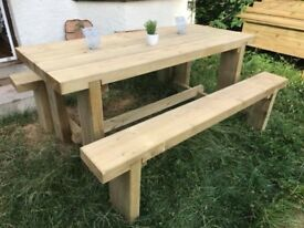 A beautiful solid garden table and 2 benches