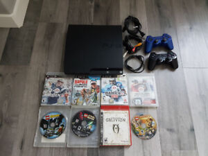 Sony PlayStation 3 with games and controllers