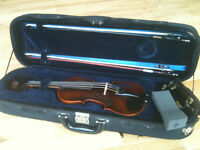 1/2 sized violin (aka fiddle) with bows, shoulder rests and case