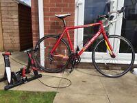 Road bike Boardman and Elite home trainer