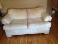 Cream color sofa and love seat