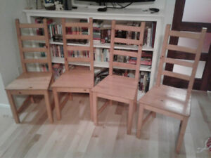 Four ladder back Ikea chairs with honey stain for sale.