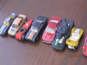 25 diecast toy cars and 5 motorcycles