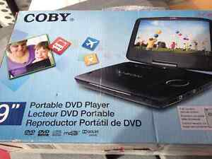 NEW PORTABLE DVD PLAYER  9 INCH ROTATING SCREEN