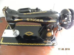Antique sewing machine with cabinet and stool