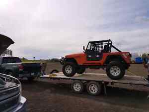18ft deck trailer with hydraulic tilt deck and winch