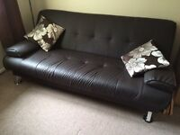 Faux leather black sofa bed (plastic)