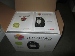 Never used and in the box Tassimo brewing system.