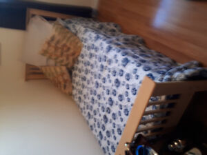 Twin beds with mattresses