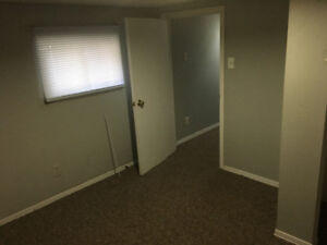 2/3 bedroom main level and basement in older home duplex