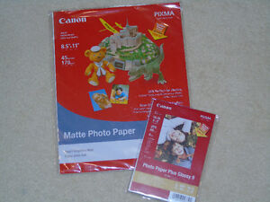 2 Unopened packages of Canon photo paper
