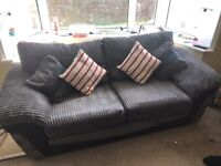 3 seater grey DFS sofa with leather front