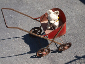 Antique teddy bear and toy metal stroller