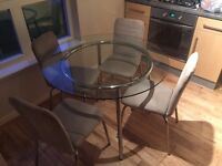 Glass Dining Table with 4 suede chairs