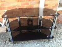 Black / chrome shinny glass tv stand. Can deliver.