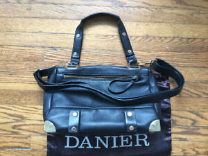 Danier black leather purse with gold accents