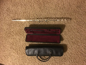 Yamaha flute with case and conn saxophone