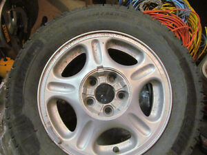 Set of (4) Michelin winter tires on rims 205/65R15