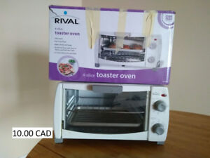 Toaster Oven - practically new (used ~ 4 times) 10.00$