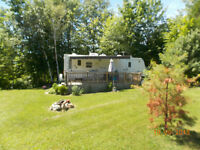 Trailer with site at Twin Pines Campground, Otter Lake