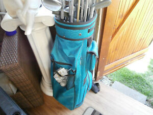 1 bag of golf clubs left by old owner of house
