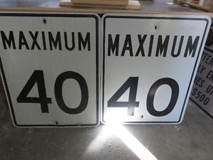 TWO METAL 40 KM DRIVING SIGNS BOTH ONE PRICE asking $55