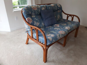 Rattan love seat with cushions