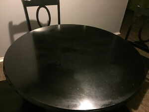 Black round dining table with 4 chairs