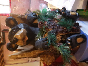 Cute holiday bear in a tree trunk