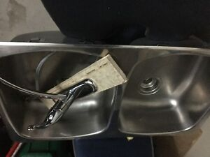 bathroom sinks and kitchen sink with Moen faucet