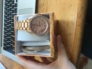 Michael Kors rose gold watch and matching braclet