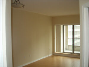 Bay Street 1+den condo with parking and locker